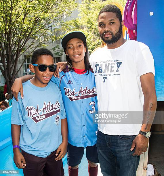 Pitcher Mo'ne Davis of Philadelphia Little League Baseball Team Taney Dragons and stepfather Mark Williams attends the parade celebrating the team on...