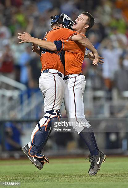 Pitcher Nathan Kirby and catcher Matt Thaiss of the Virginia Cavaliers celebrate after the final out to beat the Vanderbilt Commodores 42 to win the...