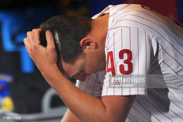 Pitcher Nick Pivetta of the Philadelphia Phillies reacts in the dugout after getting pulled from the game in the fourth inning against the Washington...