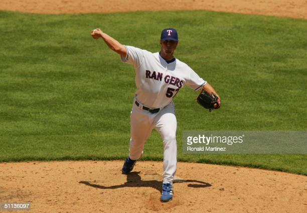 Pitcher Nick Regilio of the Texas Rangers delivers against the Anaheim Angels during the game at Ameriquest Field in Arlington on July 22, 2004 in...