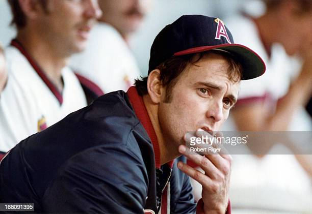 Pitcher Nolan Ryan of the California Angels sits on the bench during an MLB game circa 1973 at Angel Stadium in Anaheim California