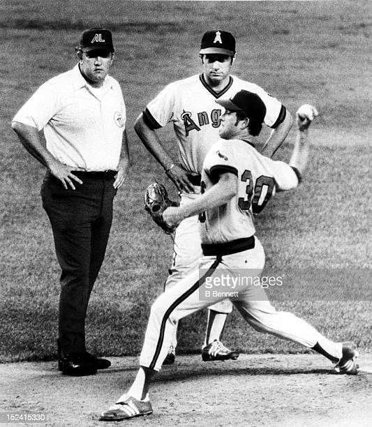 Pitcher Nolan Ryan of the California Angels throws a few warm-up pitches in the second inning after injuring his pitching elbow as manager Jim...