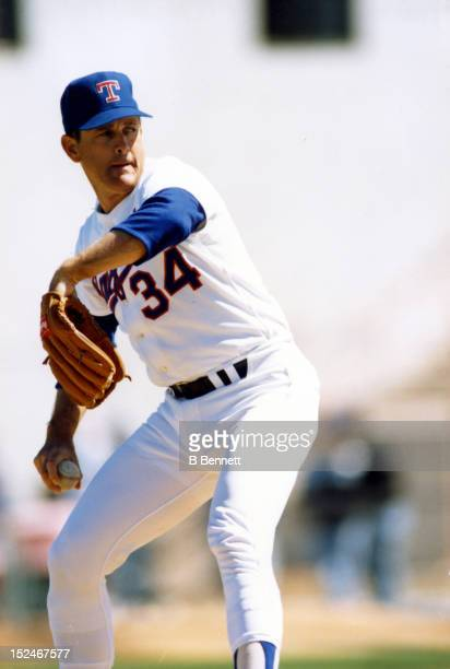 Pitcher Nolan Ryan of the Texas Rangers pitches during an MLB spring training game in March, 1992 at Pompano Beach Municipal Stadium in Pompano...