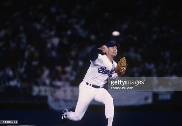 Pitcher Nolan Ryan of the Texas Rangers struck out Oakland Athletics Rickey Henderson in Nolan's 5000th career strike out at Arlington Stadium on...