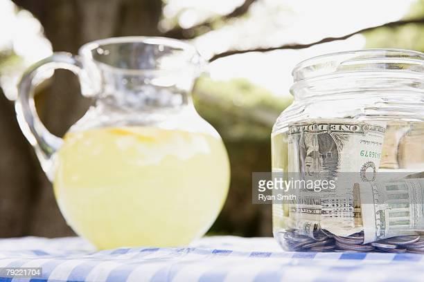 Pitcher of lemonade and a money jar