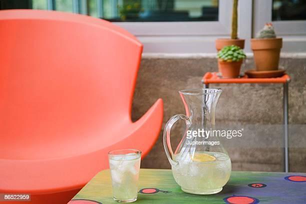 Pitcher of lemonade on table