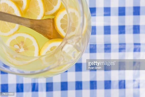 Pitcher of lemonade with lemon slices