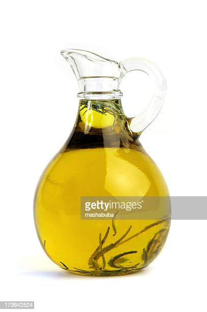 pitcher of olive oil with rosemary - olive oil stock pictures, royalty-free photos & images