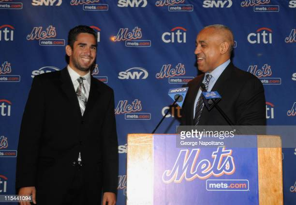 Pitcher Oliver Perez and New York Mets General Manager Omar Minaya attend a press conference to announce Perez's resigning with the Mets at SNY...