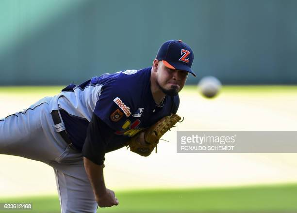 Pitcher Omar Bencomo of Aguilas del Zulia from Venezuela throws against Criollos de Caguas from Puerto Rico during the Caribbean Baseball Series at...