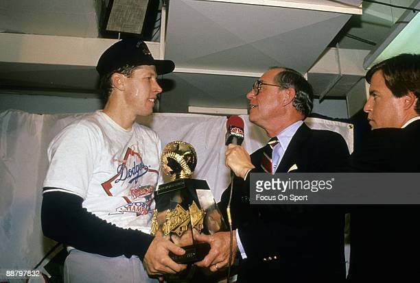Pitcher Orel Hershiser of the Los Angeles Dodgers and MVP of the 1988 World Series in the Dodgers locker room being presented with the Most Valuable...