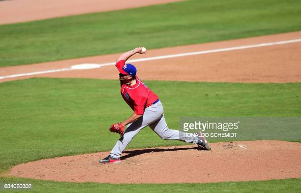 Pitcher Orlando Roman of Criollos de Caguas of Puerto Rico throws against Aguilas del Zulia of Venezuela during the Caribbean Baseball Series at the...