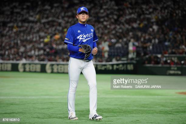 Pitcher Park Sewoong of South Korea walks to the dugout as he is withdrawn after the RBI double by Infielder Shuta Tonosaki of Japan in the bottom of...