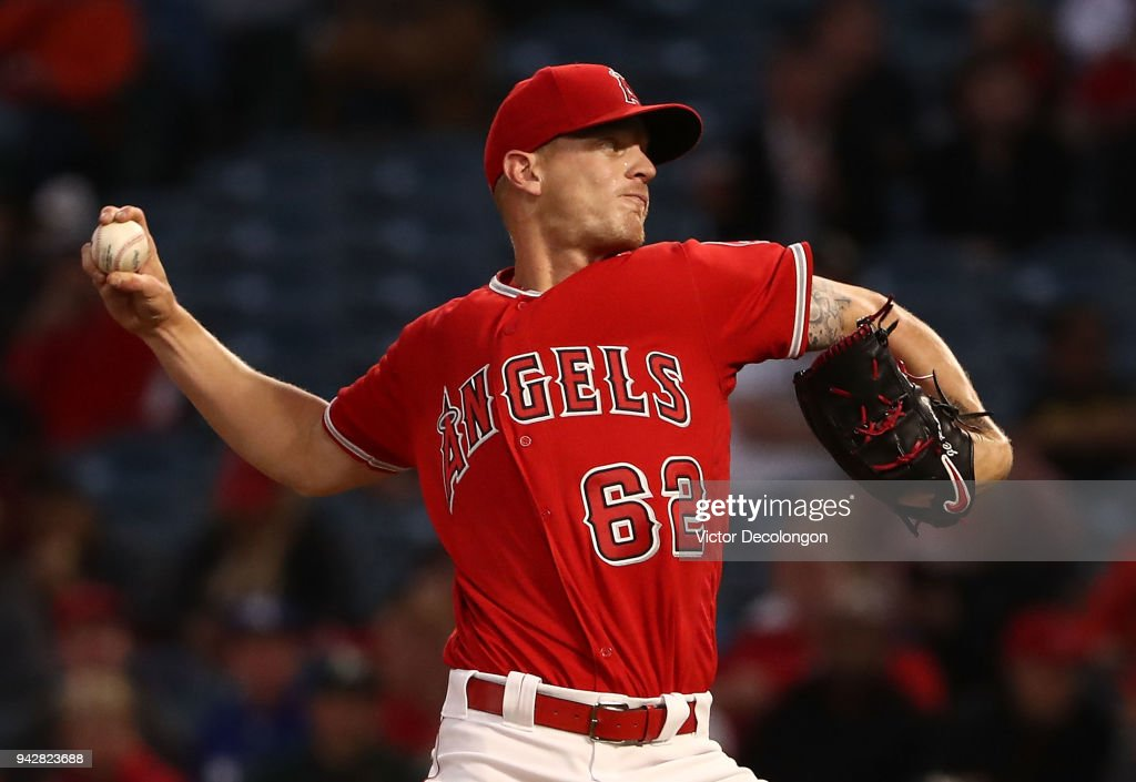 Pitcher Parker Bridwell #62 of the Los Angeles Angels of Anhaeim pitches in the first inning during the MLB game against the Oakland Athletics at Angel Stadium on April 6, 2018 in Anaheim, California.