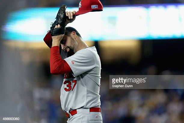 Pitcher Pat Neshek of the St Louis Cardinals reacts after giving up a homerun to Matt Kemp of the Los Angeles Dodgers in the eighth inning of Game...