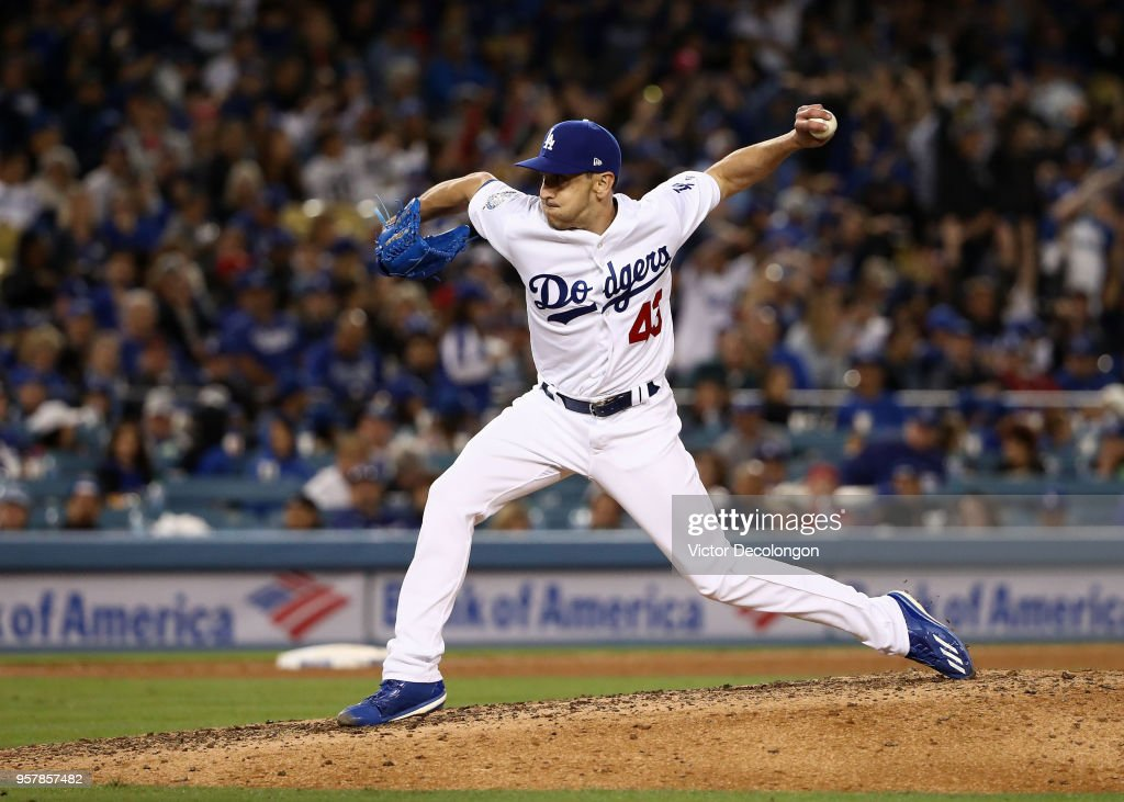 Pitcher Pat Venditte #43 of the Los Angeles Dodgers pitches as a left handed pitcher in the seventh inning to Scott Schebler #43 of the Cincinnati Reds (not in photo) during the MLB game at Dodger Stadium on May 12, 2018 in Los Angeles, California.