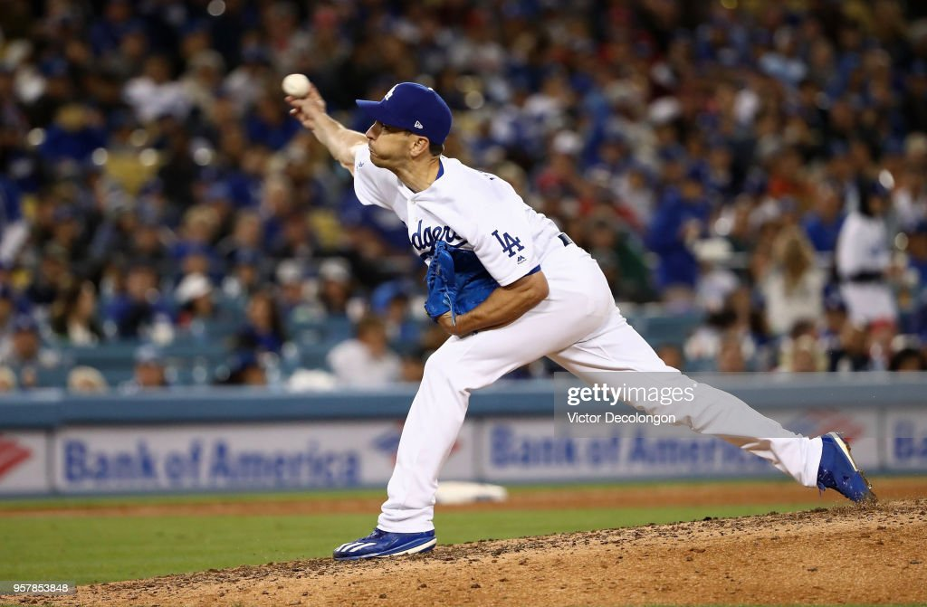 Pitcher Pat Venditte #43 of the Los Angeles Dodgers pitches as a right handed pitcher in the seventh inning against the Cincinnati Reds during the MLB game at Dodger Stadium on May 12, 2018 in Los Angeles, California.