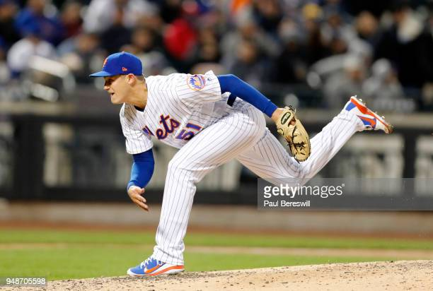 Pitcher Paul Sewald of the New York Mets follows through on a pitch in the 7th inning of an MLB baseball game against the Milwaukee Brewers on April...