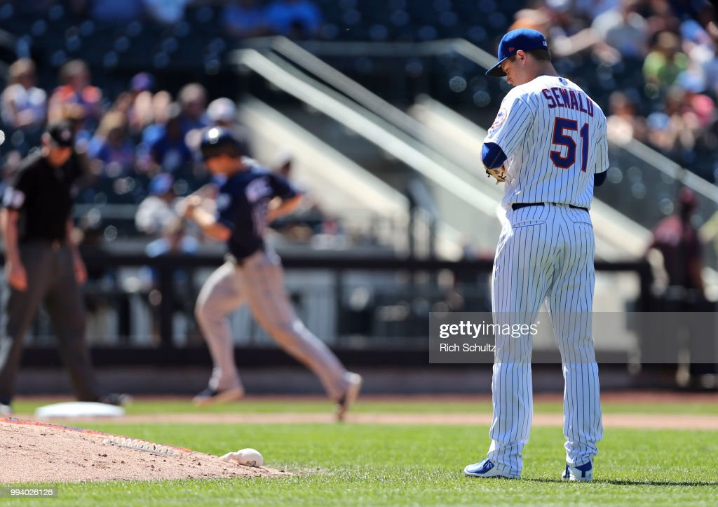 Pitcher Paul Sewald #51 of the New York Mets looks down as Joey Wendle #18 of the Tampa Bay Rays rounds the bases after he hit a home run during the eighth inning of a game at Citi Field on July 8, 2018 in the Flushing neighborhood of the Queens borough of New York City. The Rays defeated the Mets 9-0.
