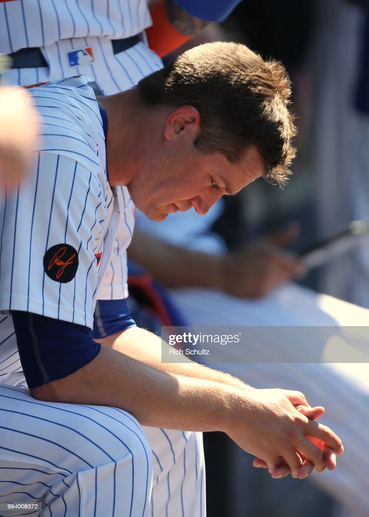 Pitcher Paul Sewald #51 of the New York Mets sits in the dugout after giving up a home run to Joey Wendle #18 of the Tampa Bay Rays during the eighth inning of a game at Citi Field on July 8, 2018 in the Flushing neighborhood of the Queens borough of New York City. The Rays defeated the Mets 9-0.