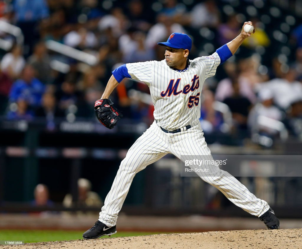 Pitcher Pedro Feliciano #55 of the New York Mets elixirs a pitch against the Philadelphia Phillies on August 26, 2013 at Citi Field in the Flushing neighborhood of the Queens borough of New York City.