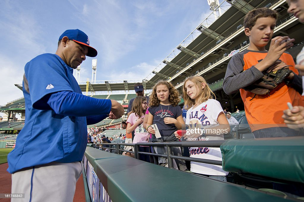 Pitcher Pedro Feliciano #55 of the New York Mets signs autographs for fans prior to the game against the Cleveland Indians at Progressive Field on September 6, 2013 in Cleveland, Ohio.