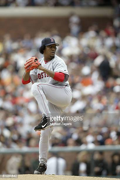 Pitcher Pedro Martinez of the Boston Red Sox pitches during the MLB game against the San Francisco Giants at SBC Park on June 19 2004 in San...