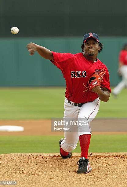 Pitcher Pedro Martinez of the Boston Red Sox pitches during the Spring Training game against the Baltimore Orioles at City of Palms Park on March 14...
