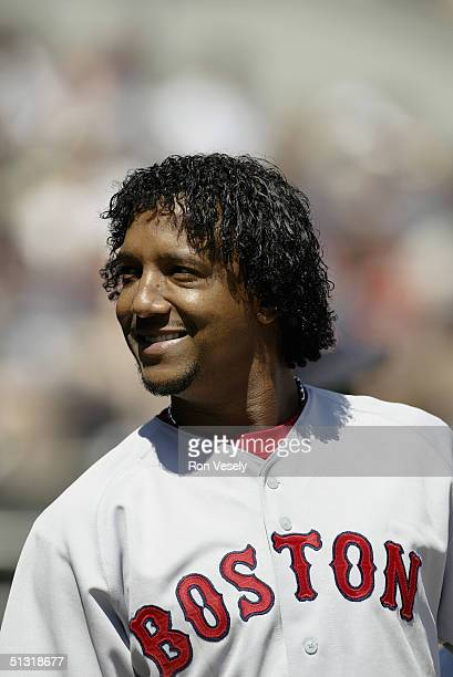 Pitcher Pedro Martinez of the Boston Red Sox smiles during the game against the Chicago White Sox at US Cellular Field on August 21 2004 in Chicago...