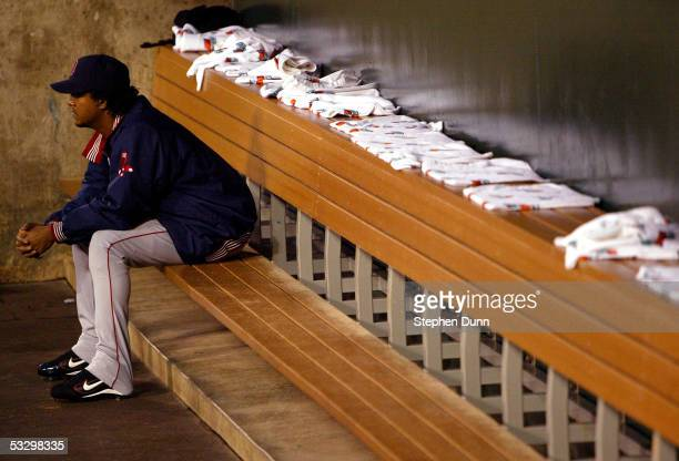 Pitcher Pedro Martinez of the Boston Red Sox watches from the bullpen during the American League Division Series with the Anaheim Angels Game Two on...