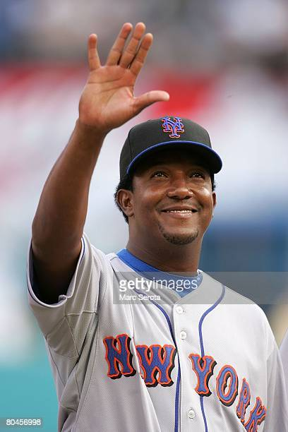 Pitcher Pedro Martinez waves to the fans against the Florida Marlins at Dolphin Stadium on March 31 2008 in Miami Florida The Mets defeated the...