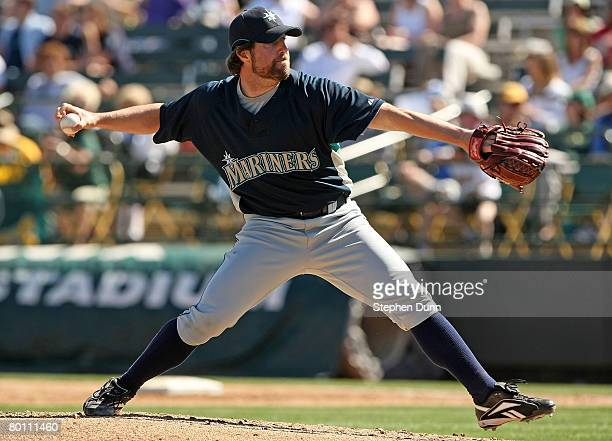 Pitcher RA Dickey of the Seattle Mariners throws a knuckleball against the Oakland A's at Phoenix Muncipal Stadium March 4 2008 in Phoenix Arizona...