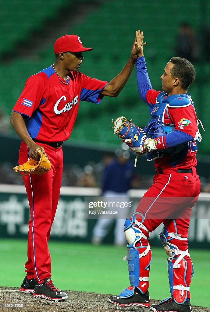Pitcher Raciel Iglesias #28 (L) and Catcher Frank Morejon #45 of Cuba celebrate winning the World Baseball Classic First Round Group A game between Brazil and Cuba at Fukuoka Yahoo! Japan Dome on March 3, 2013 in Fukuoka, Japan.