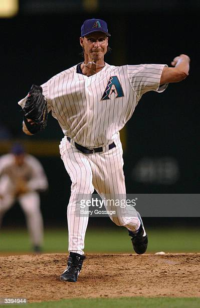 Pitcher Randy Johnson of the Arizona Diamondbacks delivers during the Opening Day game which happened to be against the Colorado Rockies at Bank One...