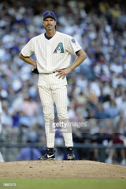 Pitcher Randy Johnson of the Arizona Diamondbacks looks on in frustration moments before being pulled from the game in the seventh inning against the...