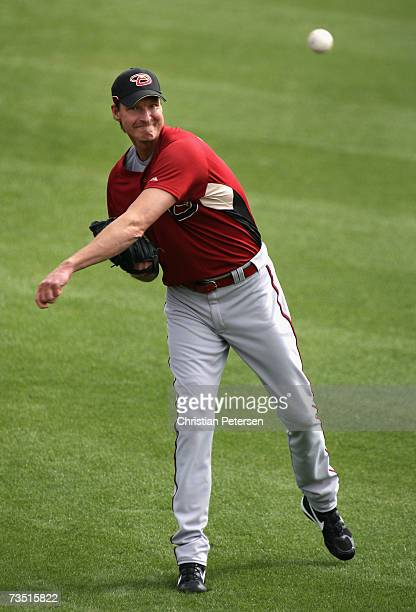 Pitcher Randy Johnson of the Arizona Diamondbacks warms up on the field before the MLB spring training game against the Texas Rangers at Surprise...