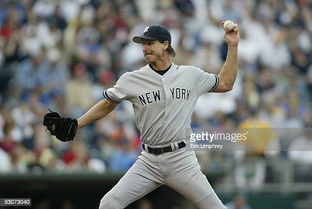 Pitcher Randy Johnson of the New York Yankees delivers a pitch against the Kansas City Royals during the game on June 1 2005 at Kauffman Stadium in...