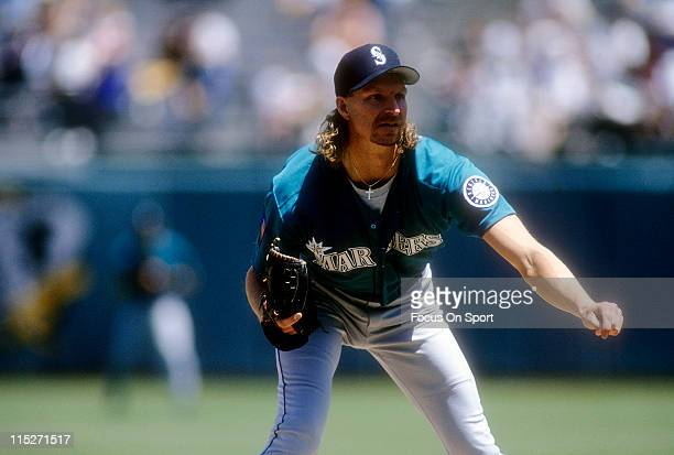 Pitcher Randy Johnson of the Seattle Mariners pitches against the Oakland Athletics during a Major League Baseball game circa 1994 at the...