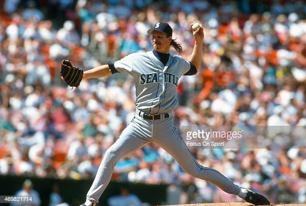 Pitcher Randy Johnson of the Seattle Mariners pitches against the Oakland Athletics during a Major League Baseball game circa 1993 at the...