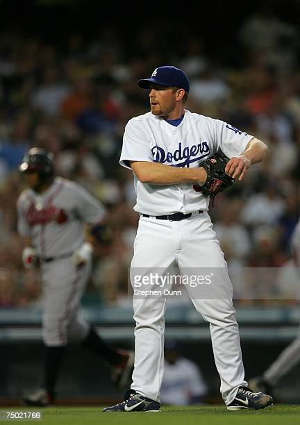 Pitcher Randy Wolf of the Los Angeles Dodgers reacts as Andruw Jones of the Atlanta Braves goes home after Wolf gave up a bases loaded walk in the...