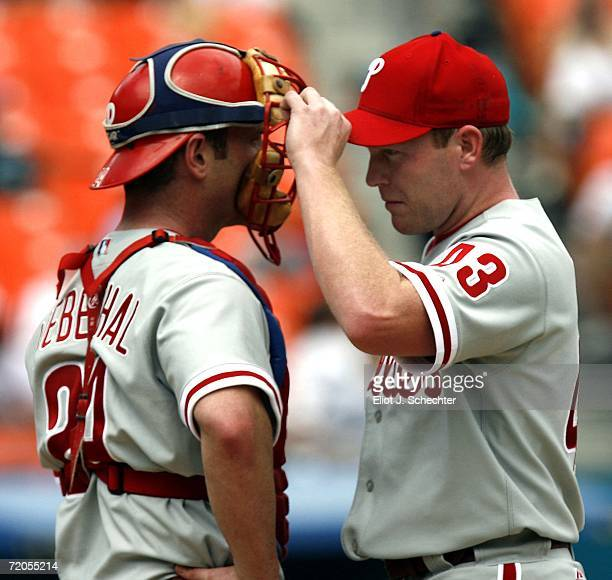 Pitcher Randy Wolf of the Philadelphia Phillies chats with teammate catcher Mike Lieberthal against the Florida Marlins on September 30 2006 at...