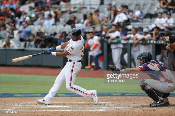 Pitcher Ricardo Gomez Caribes de Anzoategui of Venezuela throws against Aguilas Cibaeñas of Republica Dominicana during the Caribbean Baseball Series...