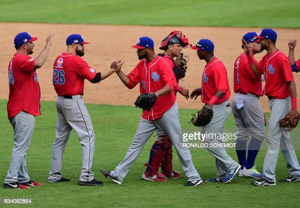 Pitcher Ricardo Gomez of Criollos de Caguas of Puerto Rico celebrates with teammates after they won the Caribbean Baseball Series semifinal match...