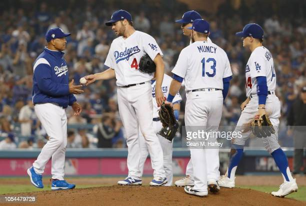 Pitcher Rich Hill of the Los Angeles Dodgers gives the ball to manager Dave Roberts as Roberts takes Hill out of the game in the seventh inning of...