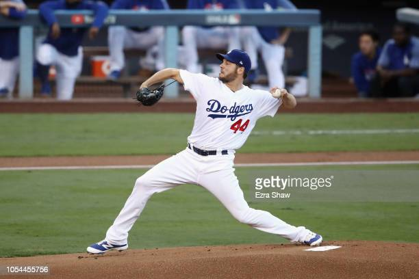 Pitcher Rich Hill of the Los Angeles Dodgers pitches in the first inning during Game Four of the 2018 World Series against the Boston Red Sox at...