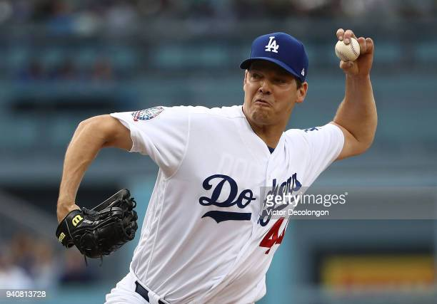 Pitcher Rich Hill of the Los Angeles Dodgers pitches in the first inning during the MLB game against the San Francisco Giants at Dodger Stadium on...