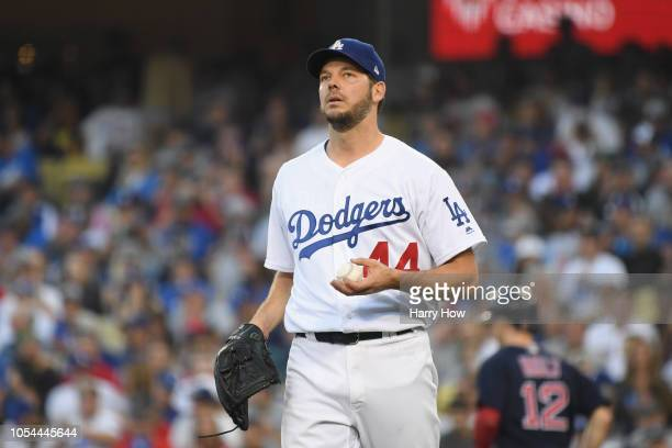 Pitcher Rich Hill of the Los Angeles Dodgers reacts after walking Brock Holt of the Boston Red Sox in the second inning of Game Four of the 2018...