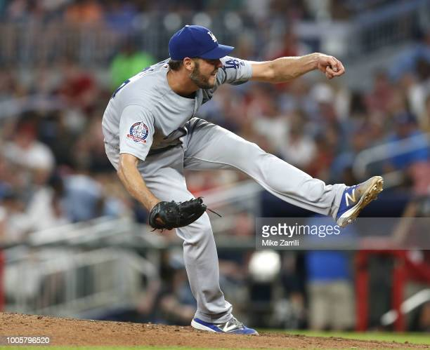 Pitcher Rich Hill of the Los Angeles Dodgers throws a ptich in the seventh inning during the game against the Atlanta Braves at SunTrust Park on July...