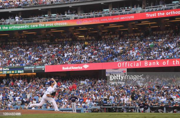 Pitcher Rich Hill of the Los Angeles Dodgers throws out the first pitch in the first inning during Game Four of the 2018 World Series against the...