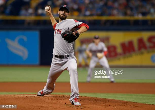 Pitcher Rick Porcello of the Boston Red Sox pitches during the first inning of a game against the Tampa Bay Rays on March 31 2018 at Tropicana Field...